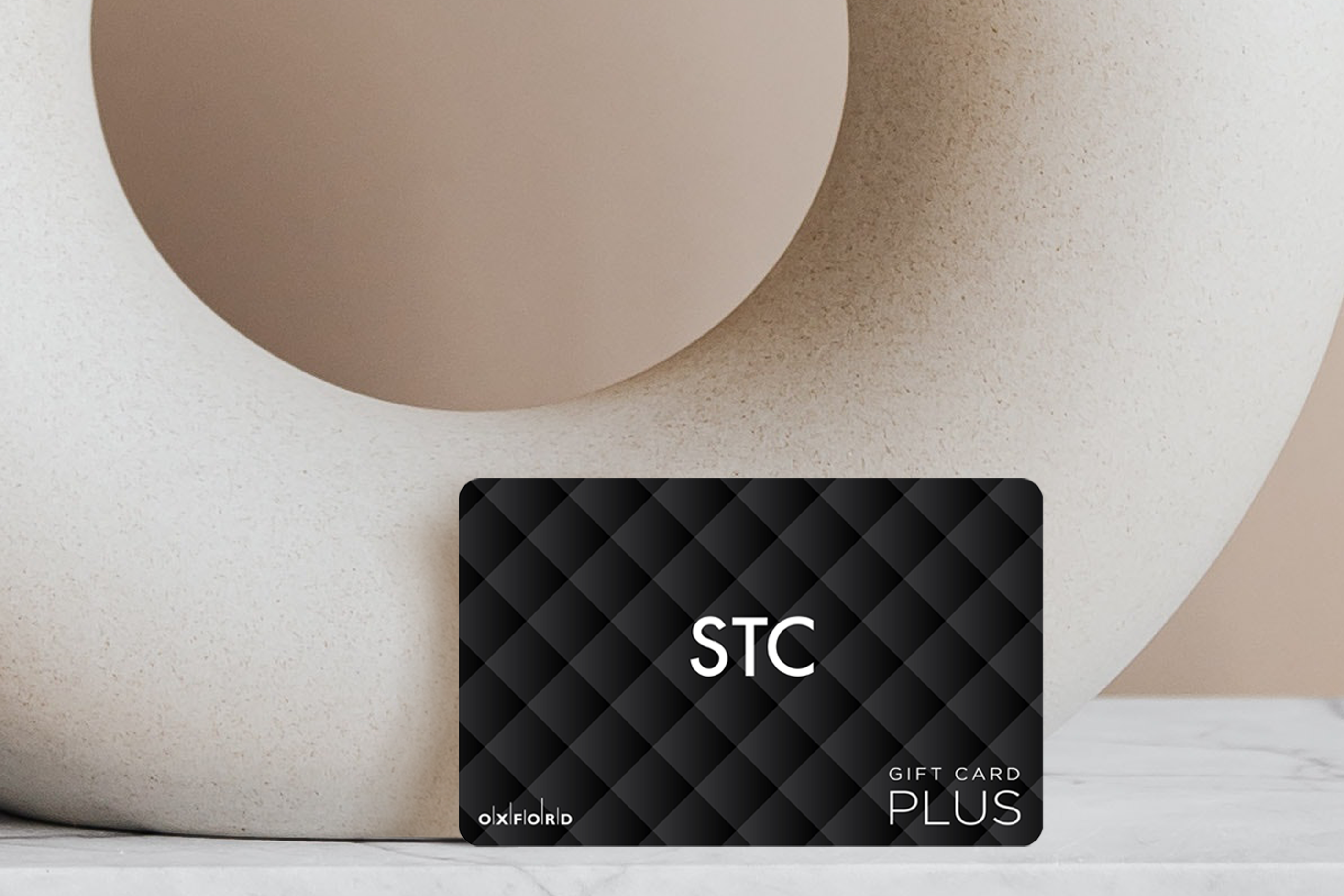 STC Gift Card Leaning on clay Pot